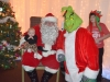 Santa, The Grinch and Ellie, who is three and a half months old.