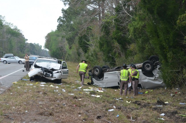 The Flagler deputy's cruiser rear-ended the van on SR100. Click on the image for larger view. (© FlaglerLive)