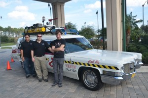 The men of 10th Voyage Studio, next to their Ghost Buster ECTO-1:  from left, Lenny Mosco, Scott Nance and Patrick Applolonia. (© FlaglerLive)