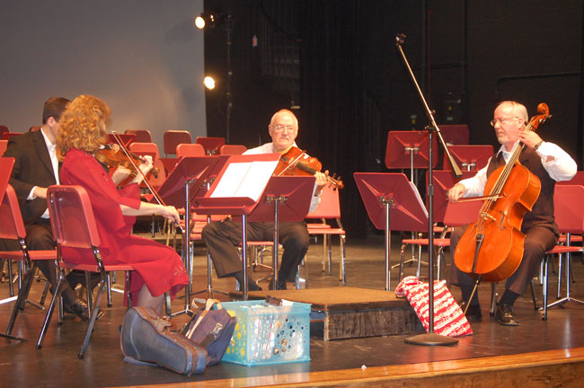 The Flagler Youth Orchestra's four music teachers, revving it up in rehearsal.
