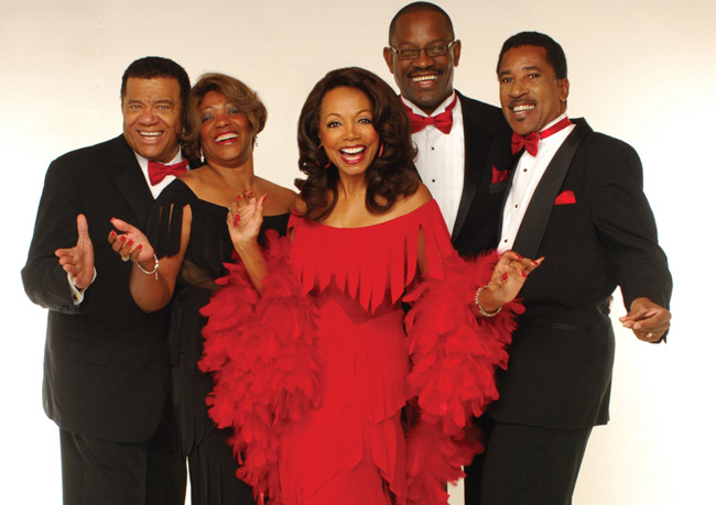 Florence LaRue and the current members of the 5th Dimension.