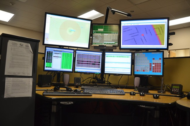 Flagler County's 911 dispatchers, who face a wall of computer screens,  can now quickly pinpoint where cell calls originate. Cell calls are the majority of calls to the 911 center. (© FlaglerLive)