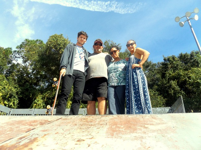 Family and friends of the late AJ Fernandez are hosting the Remembering AJ Skate Competition on Nov. 8 at Wadsworth Park in Flagler Beach. Pictured at the park's skateboarding complex are, from left: friend Joey Strople, AJ's stepfather Bill Raszl, AJ's mother Yvette Ruiz-Raszl, and friend and event organizer Carli Cipolla. Family and friends hope the benefit event not only will memorialize AJ but also bring awareness to schizophrenia and suicide prevention. All proceeds will benefit the Johns Hopkins Schizophrenia Center in Baltimore. (c FlaglerLive)