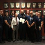 Flagler Chapter of the Sons of the American Revolution President Charles Hayes and Dr. Jeff Schaller, present the 2019 Fire Service Medal & Certificate to Palm Coast Fire Capt. James Neuenfeldt. Pictured is Deputy Chief Bradd Clark and Palm Coast firefighters.