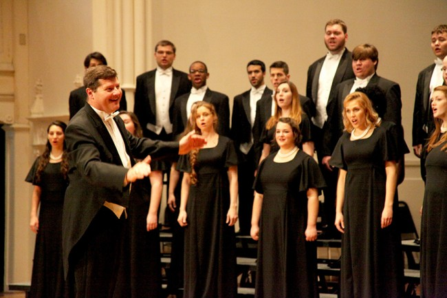 Dr. Timothy Peter, director of Stetson's choral activities, conducts the University's Concert Choir.