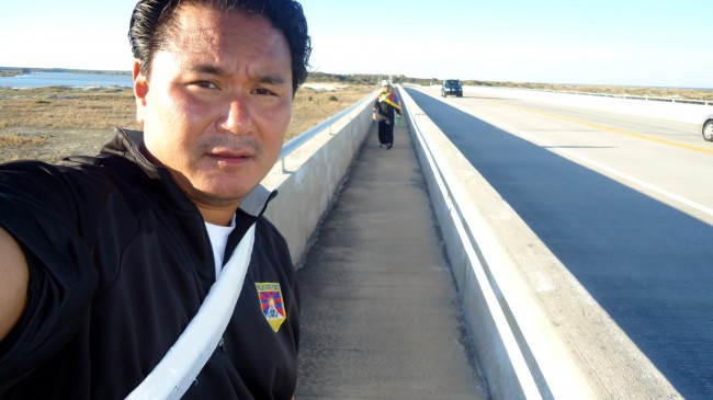 Jogme Norbu, in his last self-portrait a few hours before he was killed, with fellow-walker Wangchuk Dorjee in the distance.