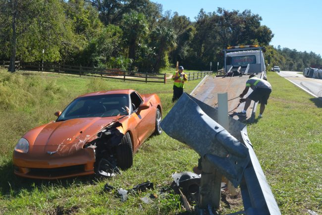 Dr. Lydia Kefalidou's Corvette after she maneuvered it out of the way of the trailer. The Corvette struck the guard rail. Click on the image for larger view. (© FlaglerLive)