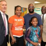 From left, Superintendent James Tager, LaShakia Moore, Tirrell Moore (husband), Kennedy Moore (daughter), Dr. Earl Johnson, Exec. Dir. Leadership and Operations. (Flagler Schools)