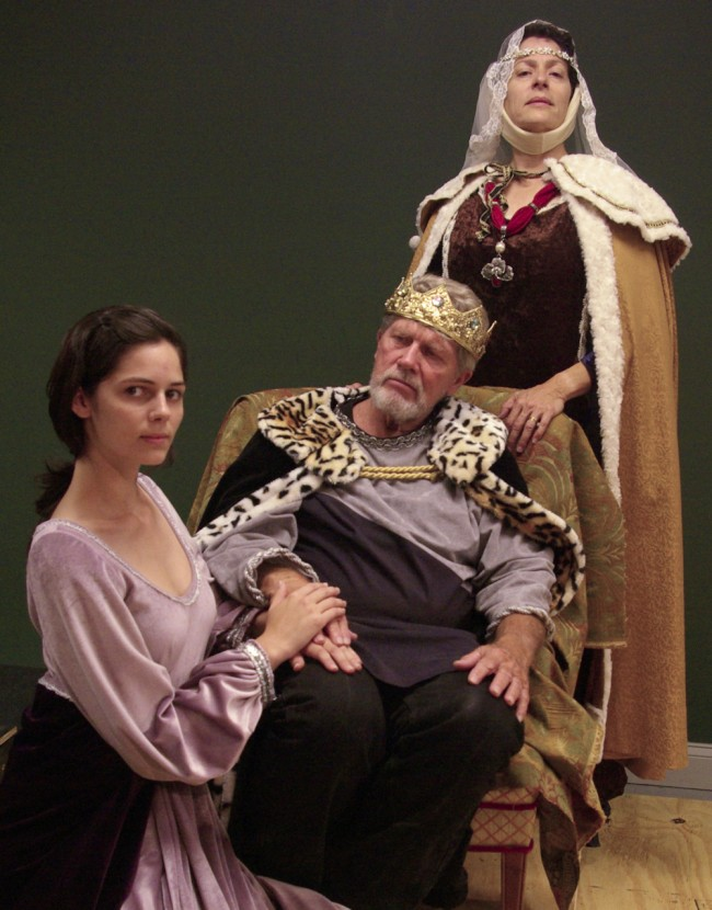 John Pope's Henry II is flanked by his mistress Alais (Kaylee Rotunno, kneeling) and his wife Eleanor of Aquitaine (Julia Davidson Truilo) in John Sbordone's production of 'The Lion in Winter,' at Palm Coast's City Repertory Theatre. The play, running this weekend and next, ends the company's second season.