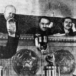 Trofim Lysenko, left, speaking at the Kremlin in 1935, with Joseph Stalin standing, right. (Wikimedia Commons)