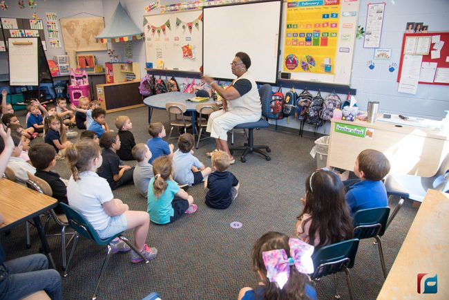 Dorothy Mayhue reads to students at Belle Terre Elementary during the school's annual African-American Read-In Thursday morning. (Flagler Schools)