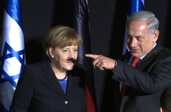 Merkel-Netanyahu-Hitler-moustache-Marc-Sellem
