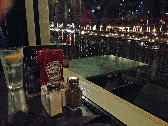 Not the greatest view out the window at A1A Ale Works: sure the first empty table is a three-top, but the empty four-top next to it stared us in the face too until it was filled half-way through our meal. (© FlaglerLive)