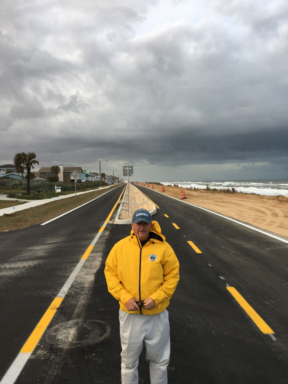 Flagler Beach City Manager Larry Newsom this afternoon on the median of the reconstructed State Road A1A, moments before it reopened to both northbound and southbound traffic for the first time in more than 300 days. (© FlaglerLive)