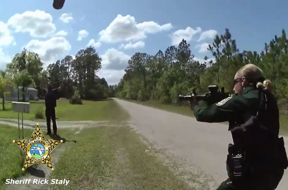 Aaron Thayer moments before he is tased at the edge of his father's property in the Mondex, or Daytona North, Saturday, in a still from body camera footage.