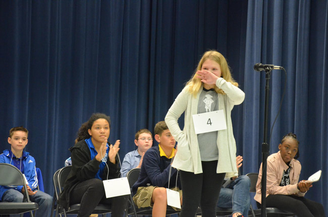 Addison Davis, a fifth grader at Old Kings Elementary, immediately after spelling 'renovate' and winning the 2019 Flagler County Spelling bee at Wadsworth Elementary Wednesday evening. (© FlaglerLive)
