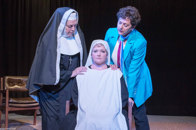 "The death of a newborn baby at a convent spurs a battle of wills – and faith – in the City Repertory Theatre production of ""Agnes of God."" The play stars, from left: Nancy Howell as the Mother Superior, Chelsea Jo Conard as Sister Agnes and Julia Davidson Truilo as the psychiatrist Martha Livingston. The play runs May 4-13 at City Rep's venue in Palm Coast. (Mike Kitaif)"