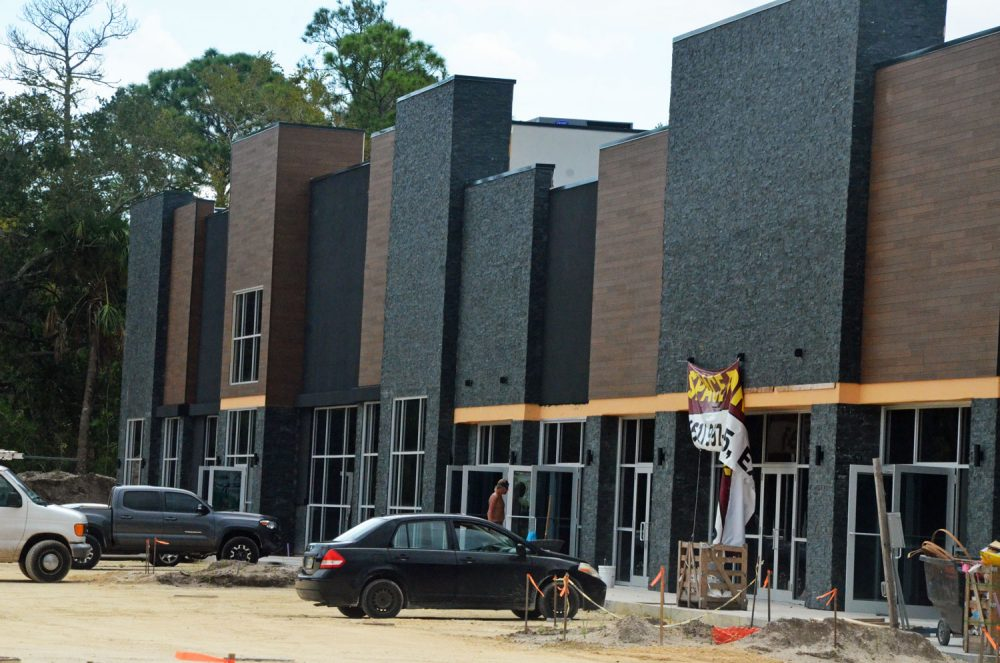 Airport Commons under construction this week. It sits at the edge of the county airport's property, opposite Wawa, along State Road 100. Its first businesses are set to open at the end of September or early October. (© FlaglerLive)