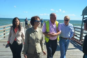 County Engineer Faith al-Khatib, left, with County Commission Chairman Barbara Revels, Flagler Beach City Manager Larry Newsom, and U.S. Sen. Bill Nelson, this morning on the Flagler Beach pier. Click on the image for larger view. (© FlaglerLive)