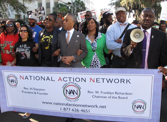 Rev. Al Sharpton (center) marches with parents and family of Trayvon Martin, Jordan Davis and others in Tallahassee on Monday in a call for a repeal of Florida's Stand Your Ground law.