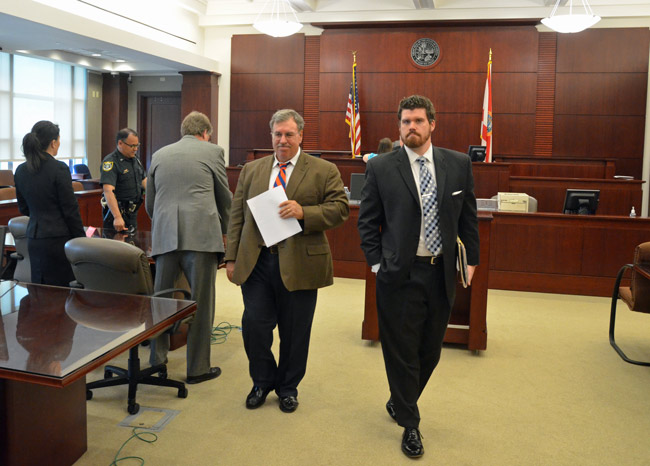 Jamesine Fischer's attorneys--Daniel Hilbert, right, and and Stephen Alexander, leaving court today--oppose a motion by the prosecution that would essentially criminalize Fischer's 11-hour silence after the November 2011 hit-and-run. (© FlaglerLive)