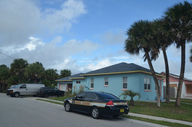 The Medical Examiner and Flagler Beach police were at Alf Olsen's property the morning of Oct. 6 as skies were darkening and the city was evacuating. Olsen, a resident at that house for the past five years, was found dead in his garage. (© FlaglerLive)