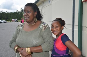 Alicia Fennell and her granddaughter Leon'ntashia Leggette, 8, who played a big role in the rescue. Click on the image for larger view. (© FlaglerLive)