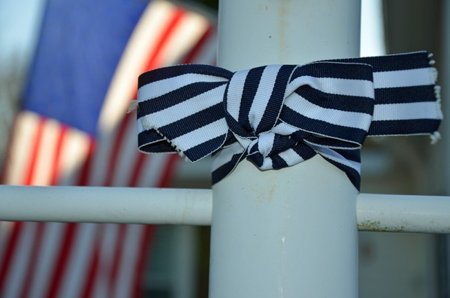 Mary Ann Dominessy Reese's campaign to bring awareness to ALS, after her December diagnosis, has spread to all 50 states with blue and white ribbons like this one, on one of innumerable lampposts in the Plantation Oaks community in Flagler Beach. (© FlaglerLive)