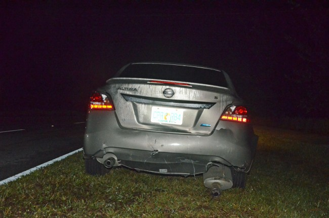 The Altima, at the head of the line of crashed cars, was least damaged. Click on the image for larger view. (© FlaglerLive)