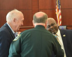 Bunnell City Manager Alvin jackson, right, with Sheriff Rick Staly and County Commissioner Charlie Ericksen earlier today, before a drug court graduation ceremony at the Flagler County courthouse. (© FlaglerLive)
