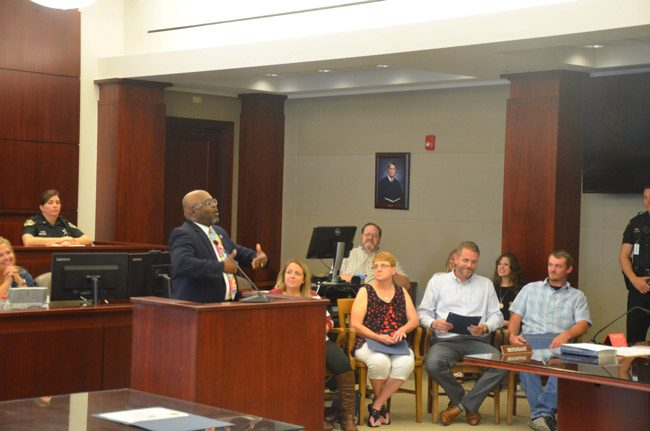 Bunnell City Manager Alvin Jackson, the keynote speaker at last week's Drug Court graduation, speaking to the four graduates--from left, Tara Williams, Pamela Guth, Alex Lape and Chad Dennis Jr. (© FlaglerLive)