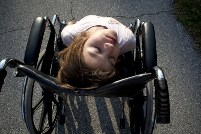 'Let the Sun Shine Down On Me,' Alyssa in her wheelchair, one of the photographs by Jennifer Kaczmarek in the latest Hollingsworth Gallery exhibit, opening Saturday. Click on the image for larger view. (© Jennifer Kaczmarek)