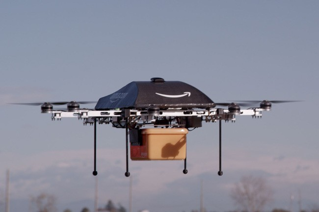 A drone on its way to deliver an Amazon Prime Air package, as shown in an Amazon publicity shot.