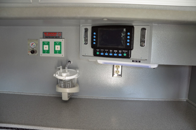 Interior ambulance equipment most of us hope we'll never see, especially when functioning. (© FlaglerLive)