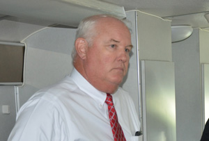 Ameris Bank Marketing President Cecil Gibson aboard the Connect Bus Tuesday. (c FlaglerLive)