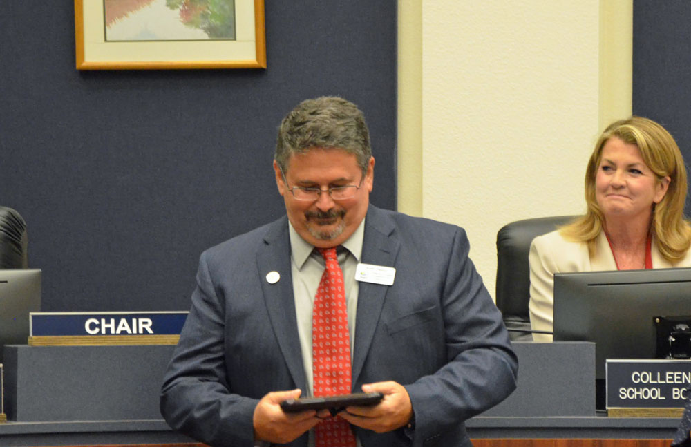 """Andy Dance last fall, accepting a plaque from his colleagues recognizing his service on the School Board since 2008. He may be wistful for the """"process"""" he was familiar with on that board. (© FlaglerLive)"""