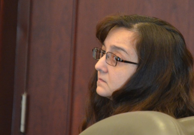 Angela Wray this afternoon, moments before she heard the judge sentence her to three years in prison. (© FlaglerLive)