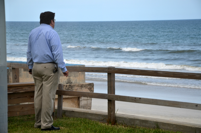 Armando and the sea: Bunnell City Manager Armando Martinez on the porch of the Beverly Beach City Hall last week, before a meeting of the Coalition of Cities, which he chairs. (© FlaglerLive)