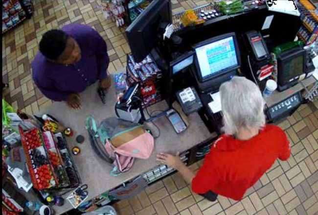 Surveillance video, which the suspect tried to demolish with a gunshot, captured the armed robbery in progress at the Circle K on Cypress Point Parkway, in an image released by the Sheriff's Office. Click on the image for larger view.