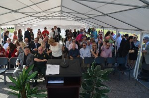 Representatives from every local government agency--with the school board's exception--many businesses and media waited for the governor's arrival under a tent. That's the eminent John Walsh, the Palm Coast Observer publisher, waving and trying to get FlaglerLive's attention to the right. (© FlaglerLive)