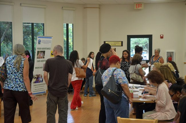 Flagler County's assistance center in the Doug Cisney Room at the Flagler County Library drew some 400 people on its first day open, Wednesday. It remains open to help people recover from Hurricane Matthew. (© FlaglerLive)