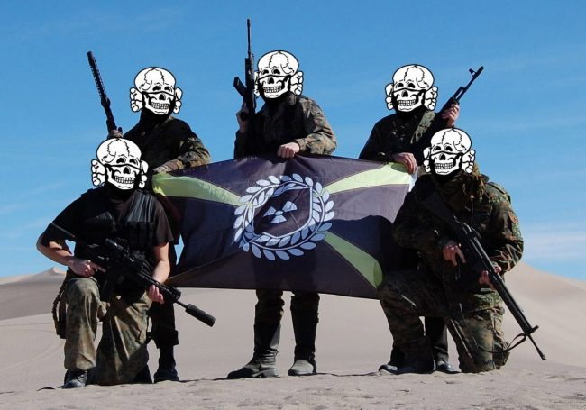 In a photo obtained by ProPublica, armed Atomwaffen members pose in the desert in Nye County, nev., during a weapons training session last month. They called the three-day gathering the Death Valley Hate Camp.