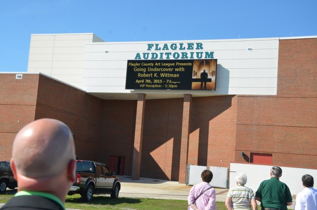 Superintendent Jacob Oliva was among several dozen people attending the first lighting of the new marquee at the Flagler Auditorium Tuesday afternoon. Click on the image for larger view. (© FlaglerLive)