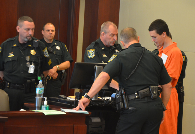Bailiffs at the center of an inquiry the sheriff has ordered reopened, seen here during court proceedings last year, include Sgt. John Bray, left, Jeffrey Puritis and John Freshcorn. Bray was the bailiffs' supervisor. (c FlaglerLive)