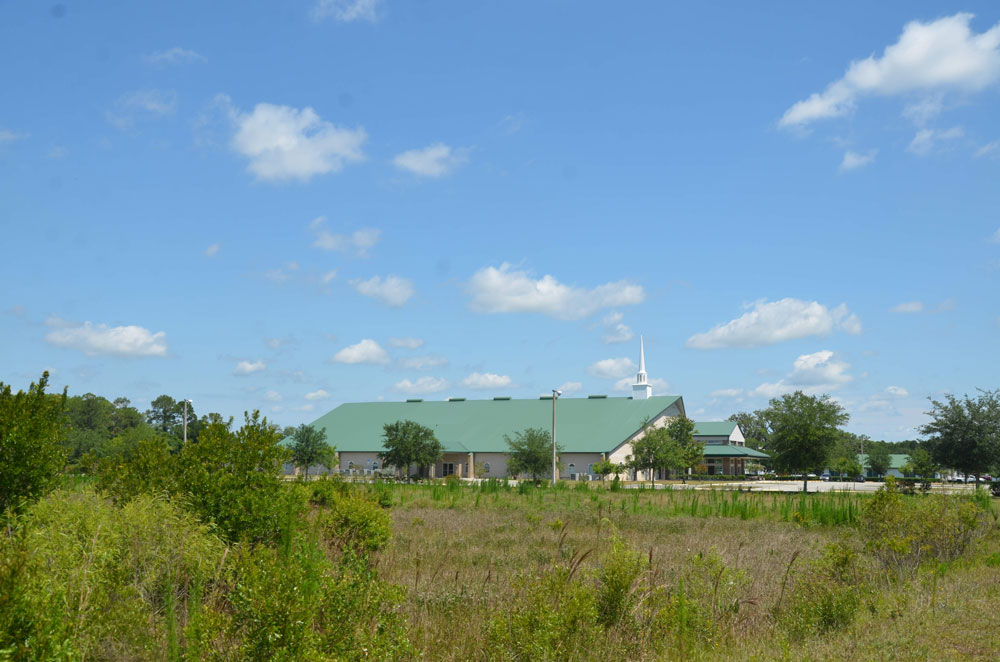 The acreage Flagler County government would like to acquire from First Baptist Church of Bunnell would allow for a branch public library to be built there. Across the street--in back of the camera angle--would go the Sheriff's Operations Center. (© FlaglerLive)