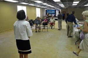 County Commissioner Barbara Revels prepares to introduce one of the smaller groups to the courthouse, before the group's guided tour. Two earlier groups had been more sizeable. Click on the image for larger view. (© FlaglerLive)