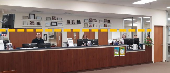 "What Supervisor of Elections Kaiti Lenhart calls ""a half-wall glass barrier"" would rise about 4 feet above front-desk staffers' counter space. (Supervisor of Elections)"