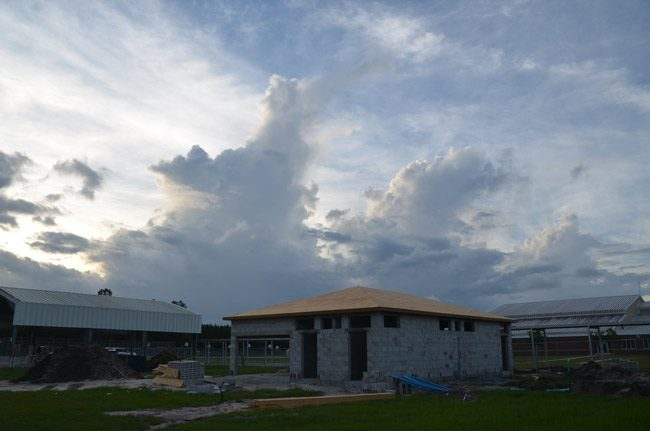 The new bathrooms under construction at the north edge of the Indian Trails Sports Complex, on school district grounds, with a hint of Winslow Homer in the air. (© FlaglerLive)