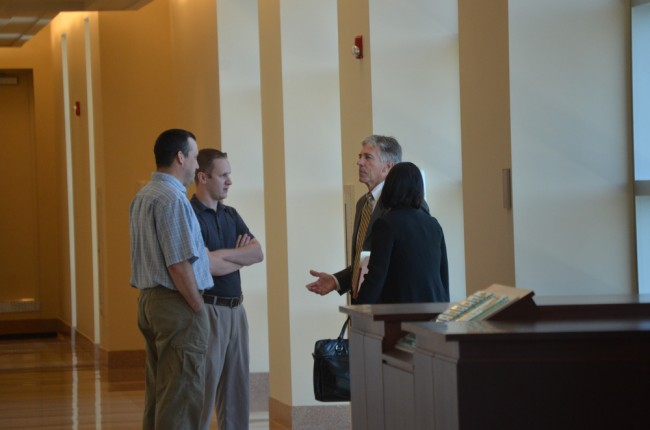 Dennis Bayer, right, with Wood and Bissonnette after a court appearance in mid-August. Click on the image for larger view. (© FlaglerLive)