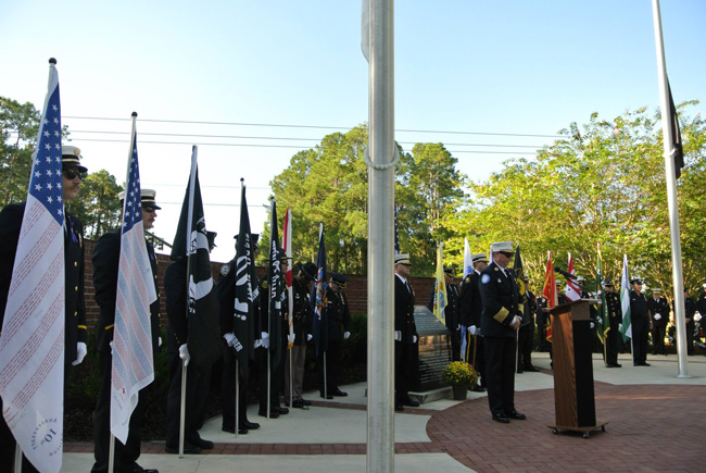 Palm Coast Fire Chief Mike Beadle, backed by an honor guard, at today's 9/11 commemoration at Heroes Park in Palm Coast. (Cindi Lane/Palm Coast)